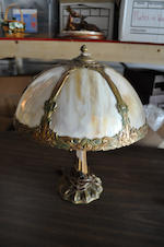 An American slag glass and gilt-metal table lamp<BR />first quarter 20th century