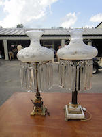 An associated pair of brass and glass oil lamps later mounted as table lamps<BR />early 20th century