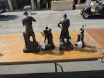 A group of four patinated bronze sculptures depicting men working