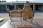 A patinated bronze sculpture of Mark Twain on a park bench<BR />by Gary Price (American, b. 1955)<BR />late 20th century