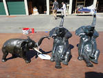 A group of three patinated bronze sculptures of elephants<BR />late 20th century