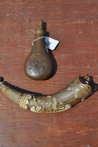 A carved powder horn and a decorated copper powder flask  20th century 13 in. (33 cm.) length of the larger. 2