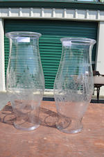 A pair of large clear glass hurricane shades<BR />20th century