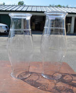 A pair of large clear glass hurricane shades 20th century
