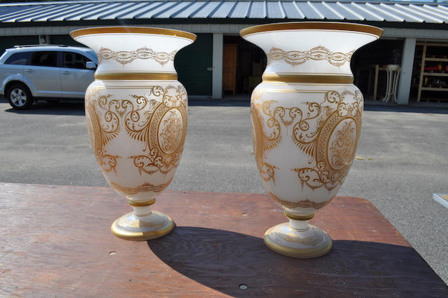 A pair of Napoleon III style gilt decorated white opaline glass large baluster vases<BR />20th century