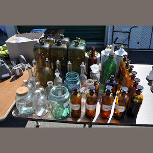 Forty glass or glazed ceramic cellarette bottles or apothecary items. mid-19th century and later