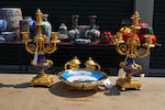 A Sevres style celestebleu gilt metal mounted and painted porcelain standish and a pair of similar three-light candelabra