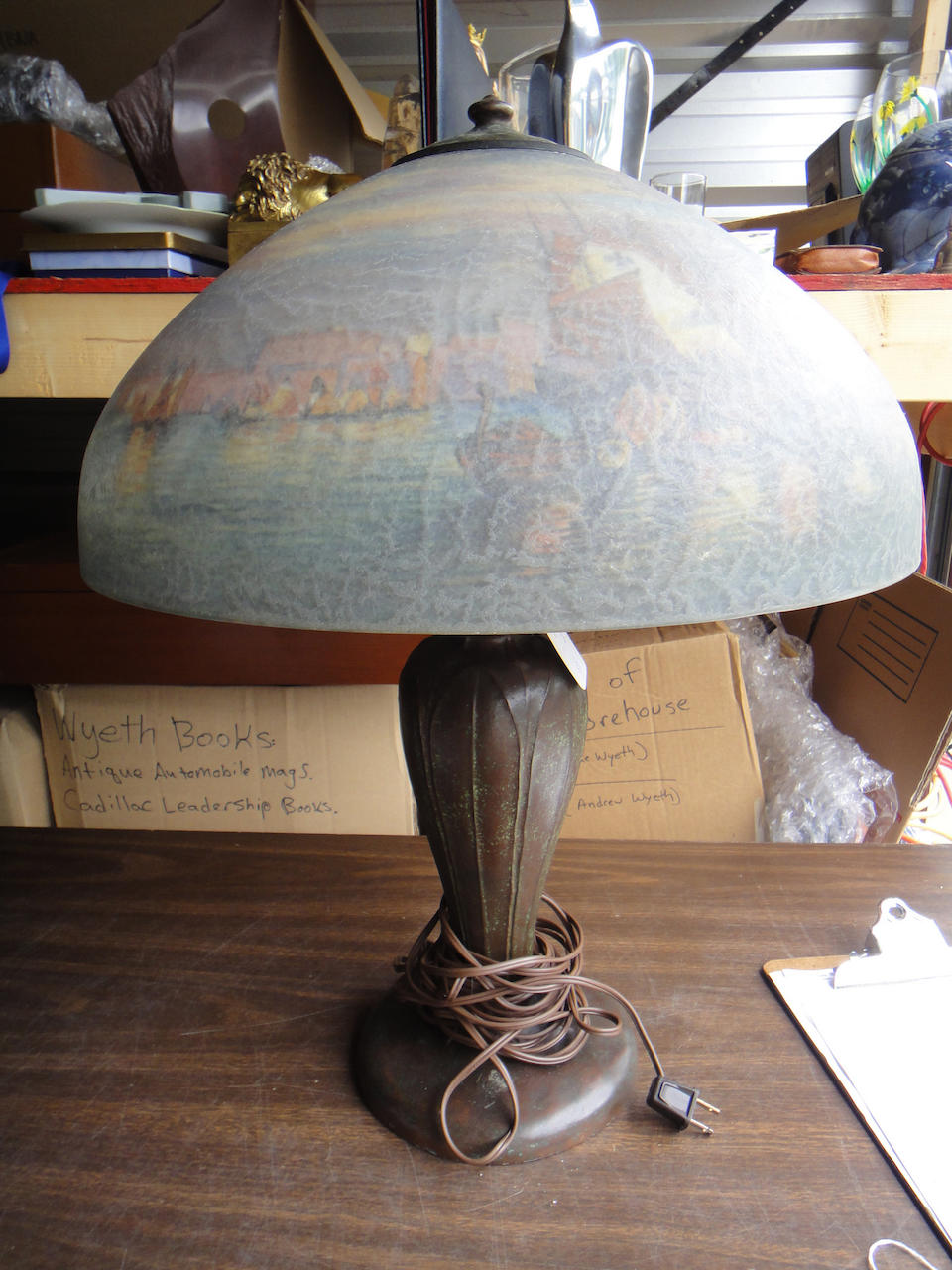 A Handel reverse-painted glass and patinated metal San Marco table lamp model 6757, first quarter 20th century