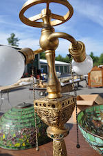 A Tiffany Studios gilt-bronze Venetian table lamp base<BR />first quarter 20th century<BR />