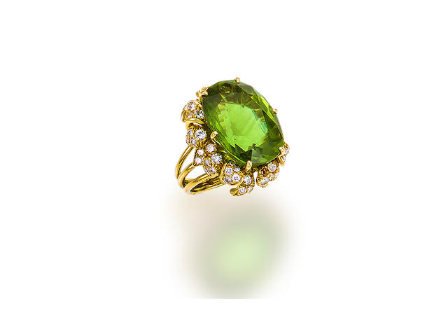 A peridot and diamond ring, Julius Cohen