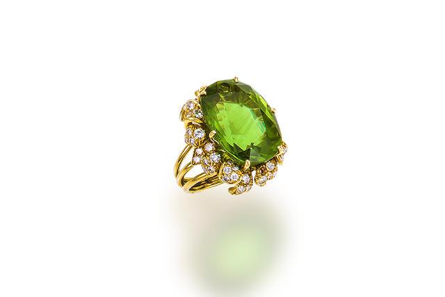 A peridot and diamond ring, Julius Cohen