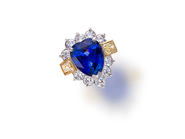 A sapphire, diamond and colored diamond ring