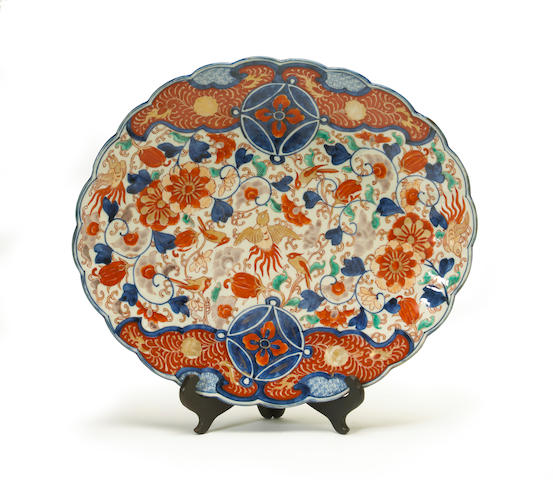 A Japanese imari porcelain scalloped charger