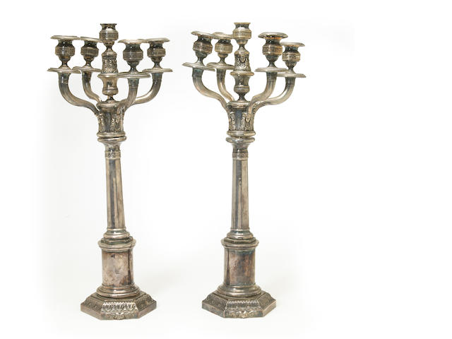 A French plated pair of Egyptian revival columnar candlesticks with hexagonal bases and five light branches with maker's initials: V.T., early 19th century