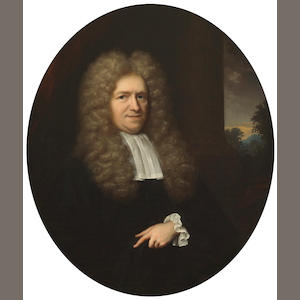 Arnold Boonen (Dordrecht 1669-1729 Amsterdam) A portrait of a gentleman, half-length, before a pillar with a landscape beyond; A portrait of a lady, half-length, in white with a blue robe (a pair) oval, 18 1/2 x 15 3/4in (47 x 40cm)