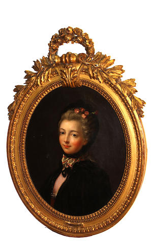 Manner of François Hubert Drouais A portrait of a young woman, bust length oval, 24 x 19 1/2in