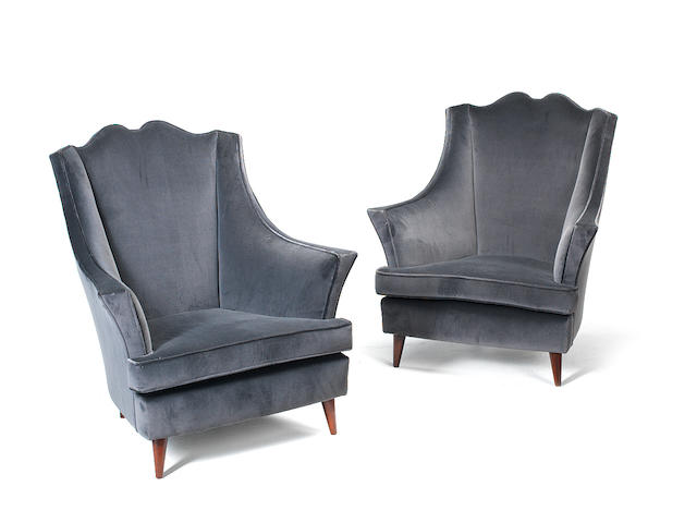 A Pair of Wingback Armchairs Italian, circa 1950  velvet upholstery and stained beech legs  Height: 37 in.                94 cm.
