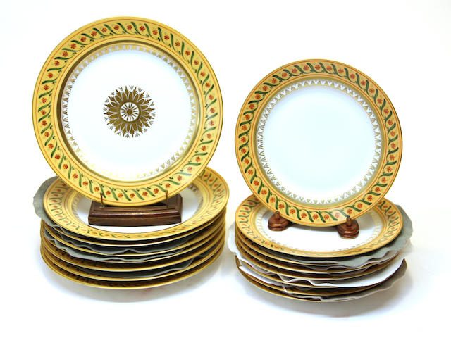 Sixteen Camille Le Tallec porcelain plates in the Bande Corail sur Bleuets pattern date codes for 1983 and 1989