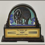 An Art Deco style mantel clock with enameled elephant decoration