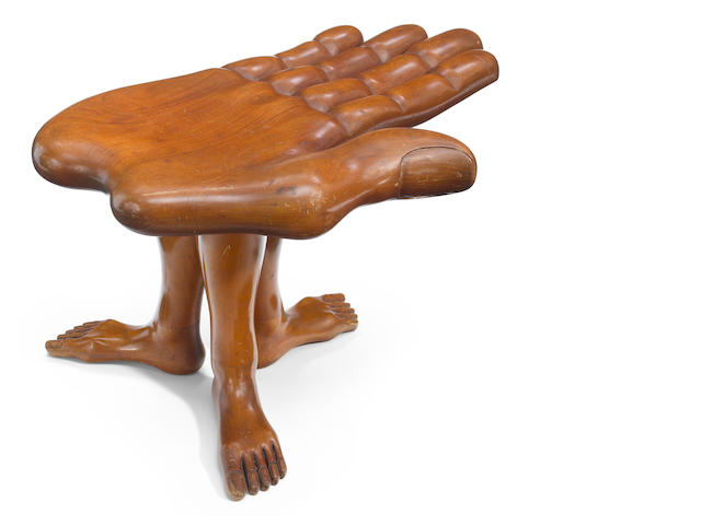 A Pedro Friedeberg carved mahogany hand foot stool  1970's