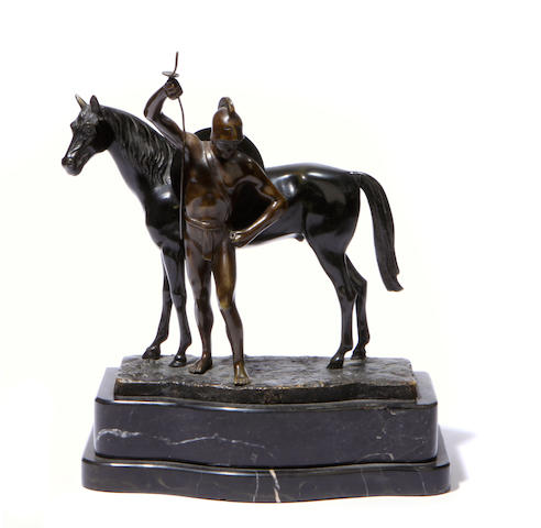 A Continental patinated bronze figure of a gladiator and horse
