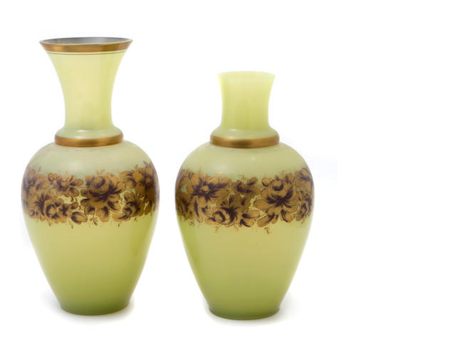 A near pair of Continental gilt heightened vaseline glass vases
