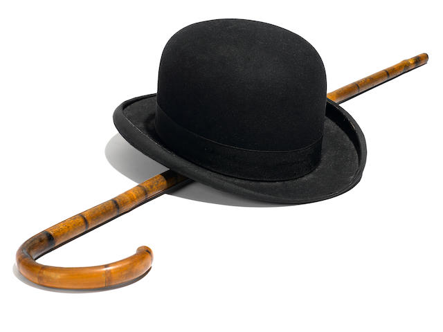 A CHARLES CHAPLIN DERBY HAT AND BAMBOO CANE, WITH LETTER OF AUTHENTICITY FROM MAMMOTH CAVE WAX MUSEUM