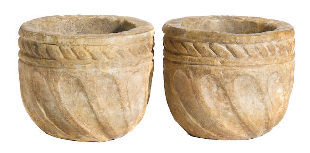 A pair of Romanesque style cast composition jardinières<BR />manner of Michael Taylor <BR />third quarter 20th century