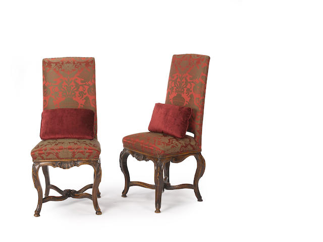 A pair of early Louis XV walnut chaises<BR />second quarter 18th century