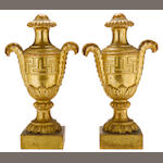 A pair of Italian Neoclassical giltwood two handled urns  <BR />late 18th century