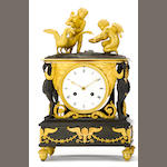 An Empire gilt and patinated bronze figural mantel clock<BR />early 19th century