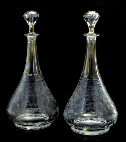A pair of Moser etched glass decanters and stoppers