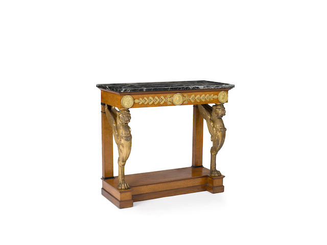 An important and fine Empire gilt bronze mounted and parcel gilt thuya wood console table<BR />attributed to Jacob Desmalter <BR />early 19th century