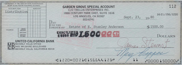 A JIMMY STEWART PHOTO AND SIGNED BANK CHECK