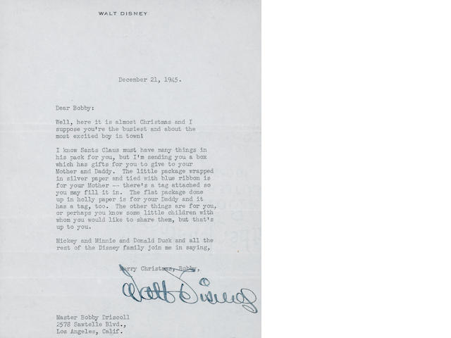 A FRAMED WALT DISNEY TYPED, SIGNED LETTER.  A CHRISTMAS GREETING. DATED DECEMBER 21, 1945.