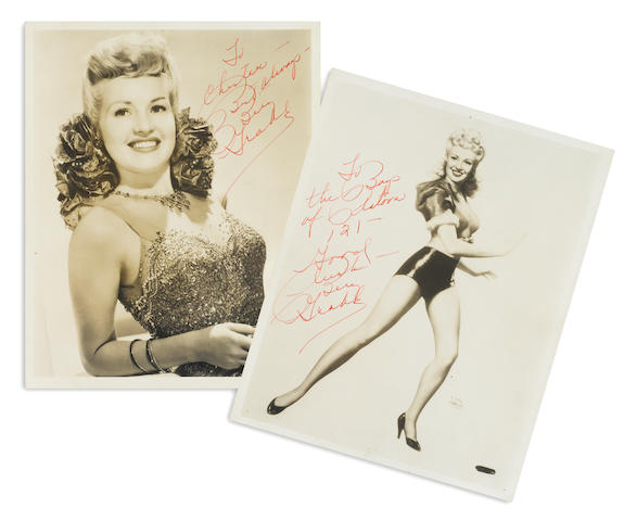 A pair of Betty Grable signed photographs