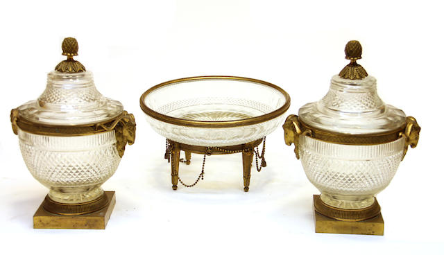 A pair of Louis XVI style gilt bronze mounted cut glass covered jars and a similar bowl early 20th century