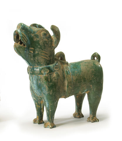 A green glazed pottery figure of a dog China, Han dynasty