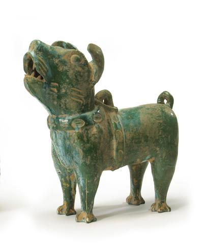 A green glazed pottery figure of a dog China, Han dynasty