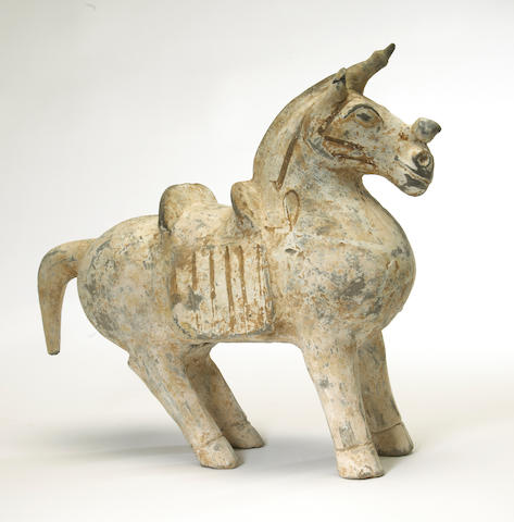 An archaistic painted pottery funerary model of a saddled horse