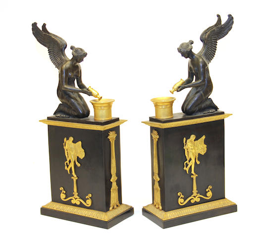 A pair of Empire style patinated and gilt bronze figural mantel ornaments 20th century