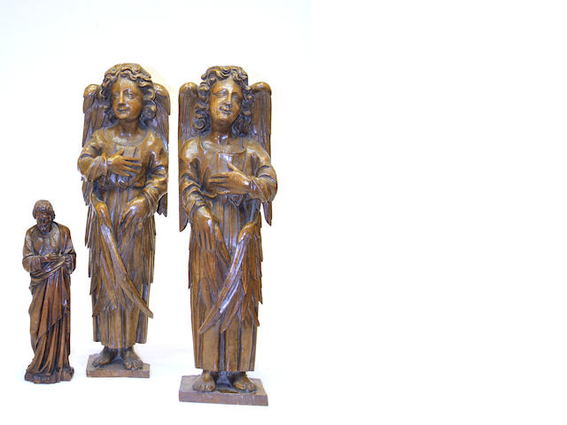 A pair of Continental carved oak figures of angels and figure of an apostle second half 19th century