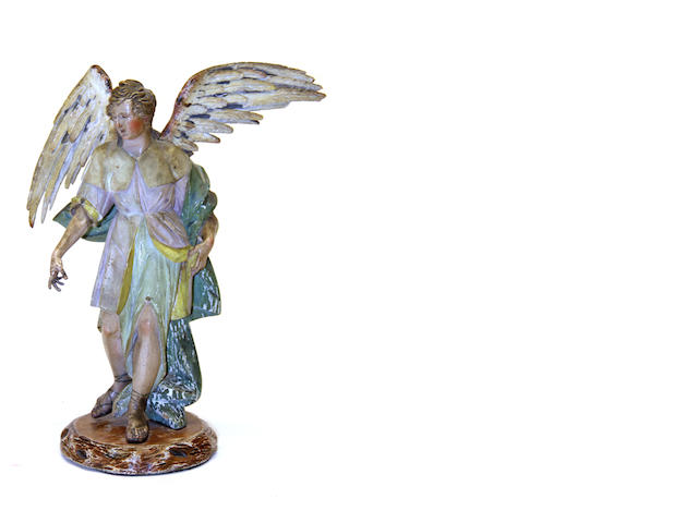 An Italian carved and polychrome wood figure of an angel first half 19th century