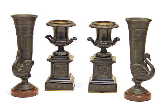 A pair of Greek revival patinated bronze and slate two handled mantel urns and pair of Aesthetic patinated metal swan form vases fourth quarter 19th century