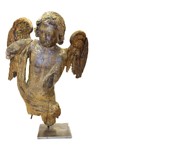 A Baroque carved wood and gesso figure of an angel  18th century