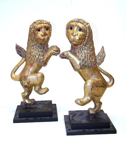 A pair of Burmese giltwood heraldic rampant lions 20th century