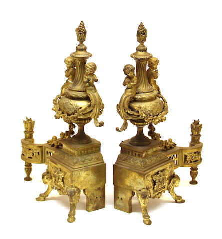 A pair of Louis XV style gilt bronze chenets late 19th/early 20th century