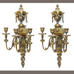 A pair of Louis XVI style cast brass three light bras de lumière fourth quarter 20th century