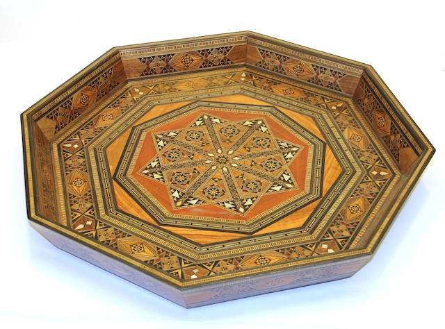 A North African octagonal parquetry inlaid wood tray late 20th century