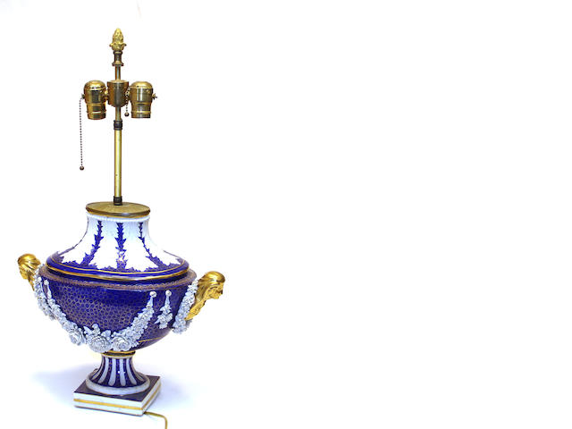 A Sèvres style glazed and bisque porcelain navette form urn, now as a lamp first half 20th century
